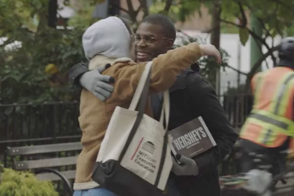 Hershey's ad scene featuring people embracing.