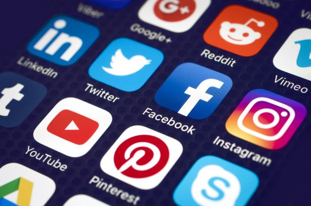 Social media app icons shown on mobile phone screen.